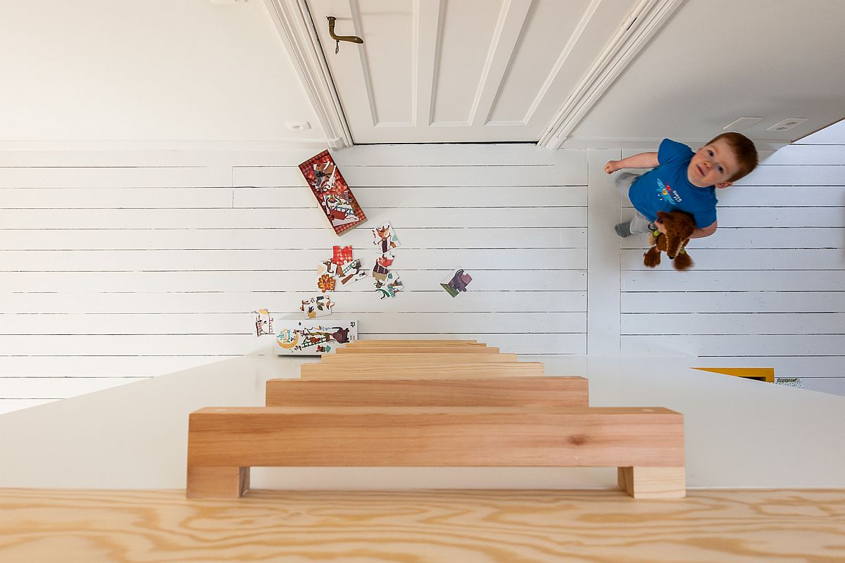 Simple-wooden-ladder-leads-to-the-loft-play-area-above-the-beds