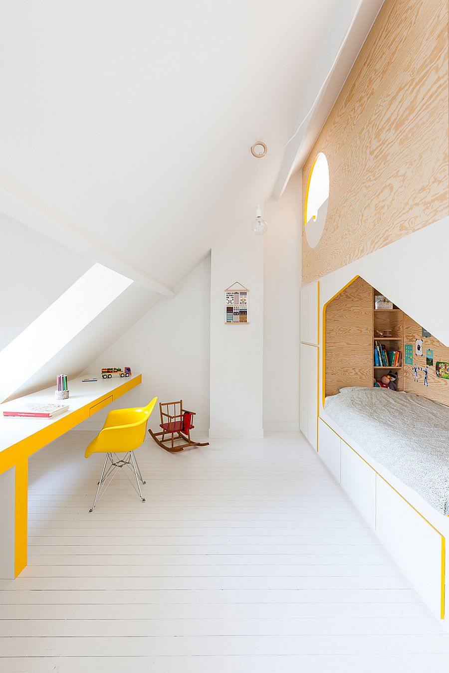 Sloping-walls-of-the-attic-add-to-the-dramatic-visual